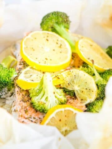 salmon with broccoli and lemon slices in parchment paper