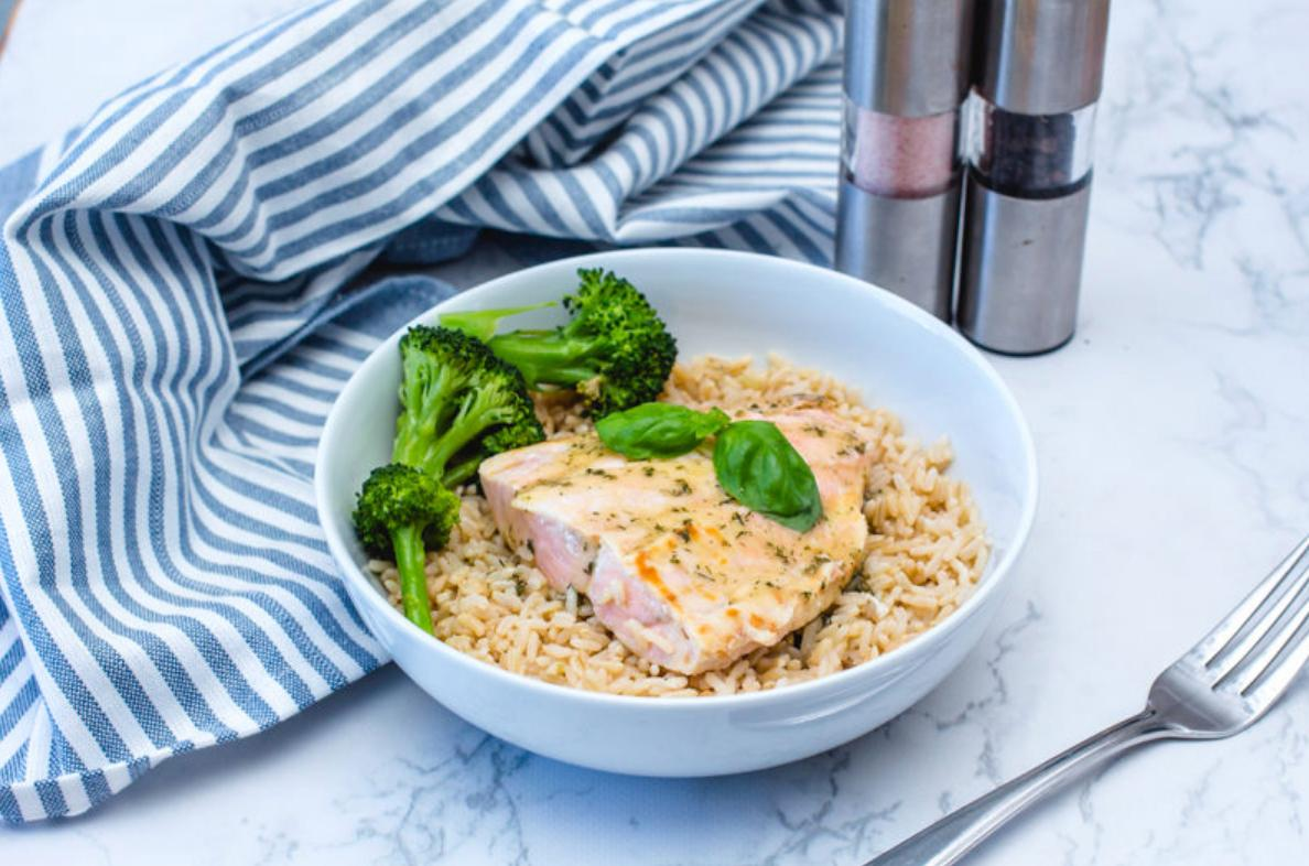 salmon over rice with broccoli in a bowl