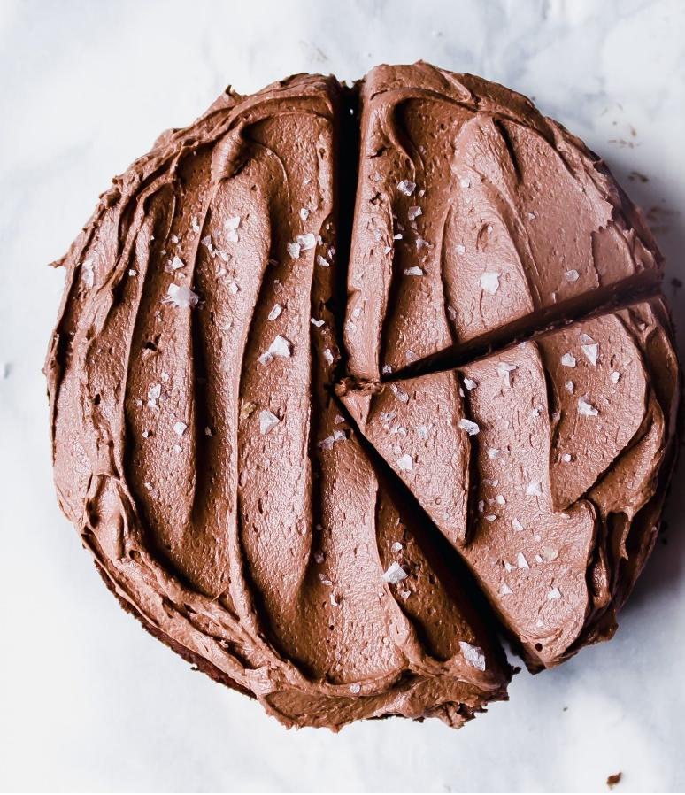 chocolate frosted cake with 2 slices cut out