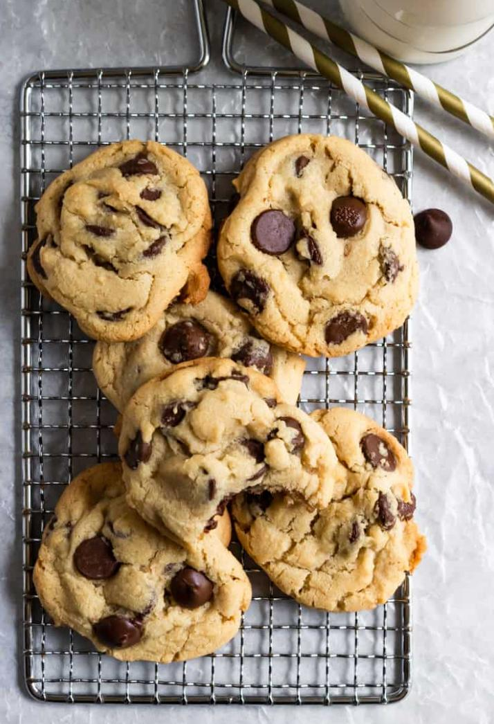 pile of chocolate chip cookies on a cooling rack
