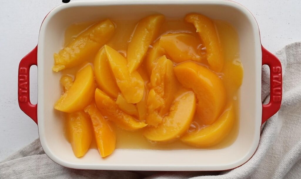 canned peaches in a rectangle pan