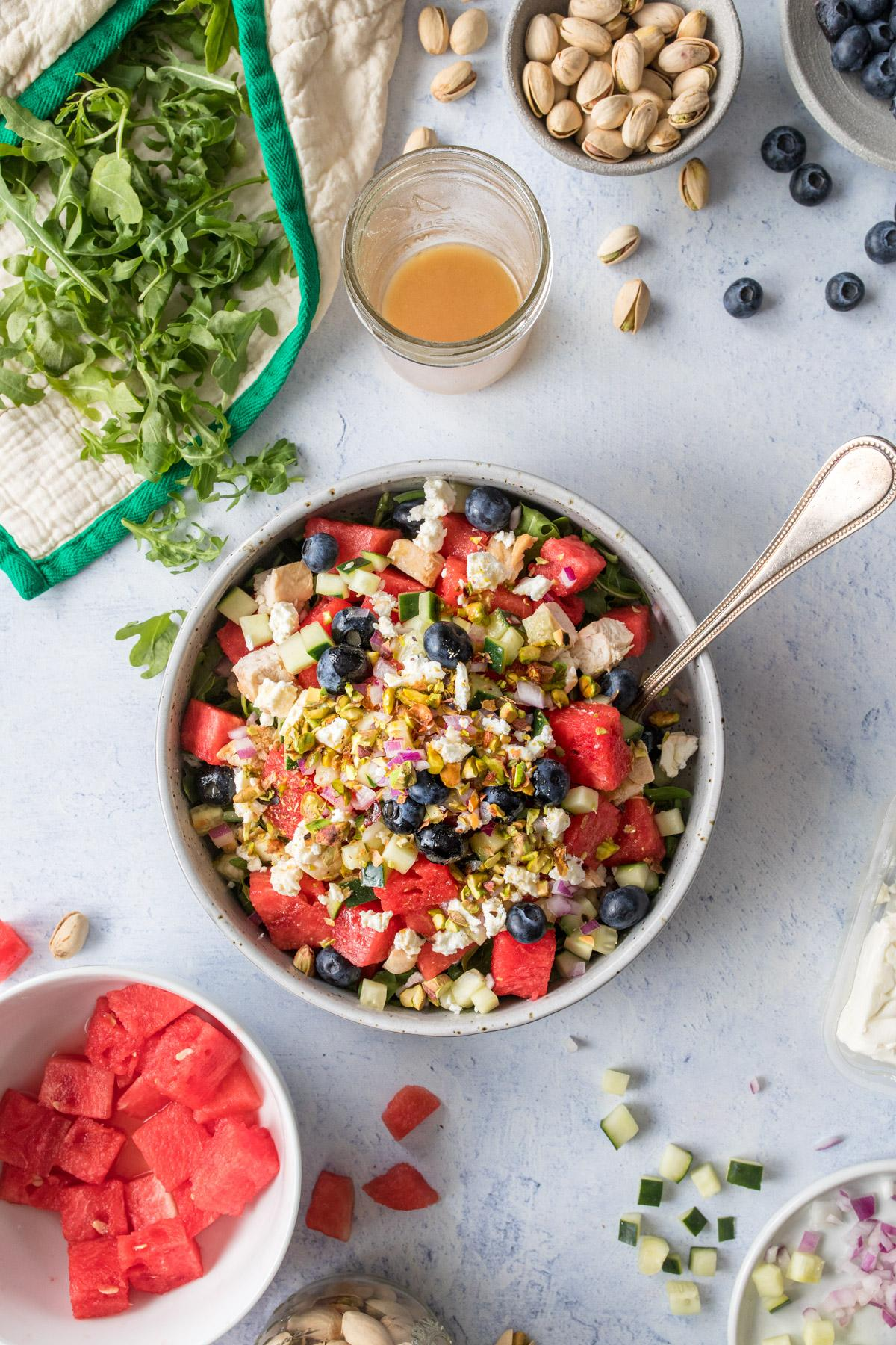 watermelon chicken and blueberry salad in a large bowl