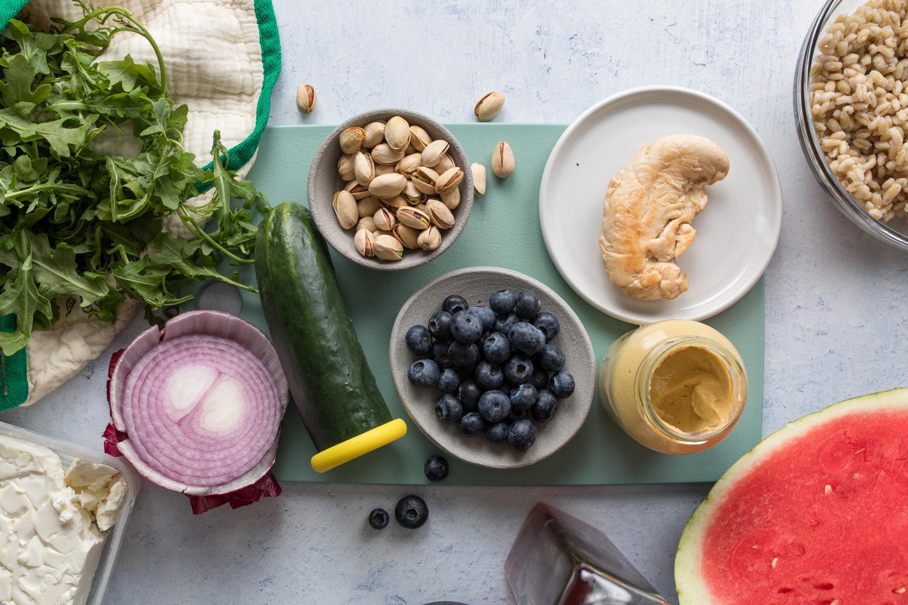 watermelon chicken salad ingredients on a cutting board