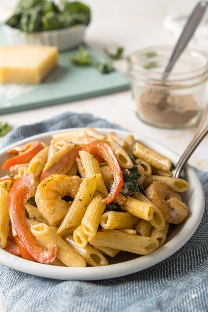close up of jerk shrimp pasta in a bowl