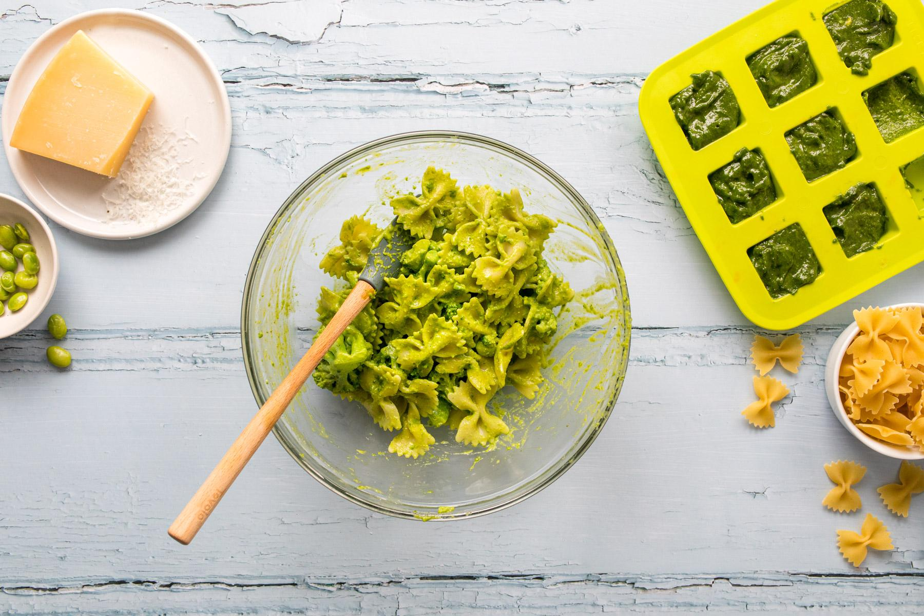 bow tie pasta with pesto in a glass bowl