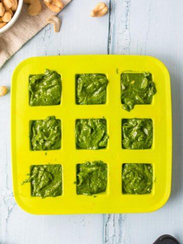 green pesto sauce in a green ice tray