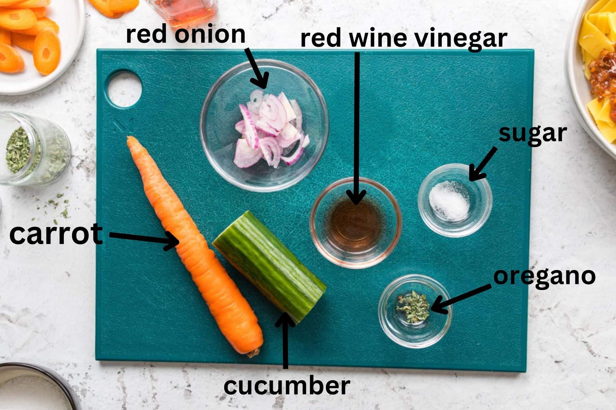 cucumber salad ingredients on cutting board